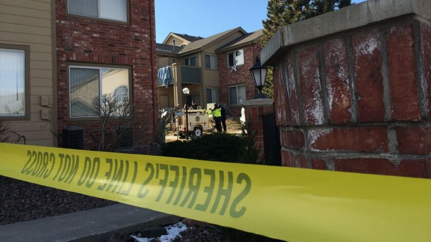 Sheriff's deputies remove a spotlight used to help investigators process evidence at an apartment where Matthew Riehl fatally shot Douglas County Sheriff's Deputy Zackari Parrish and wounded six others in the Denver suburb of Highlands Ranch on Sunday.