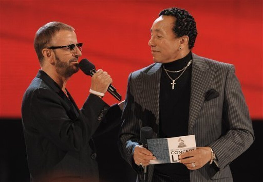 Ringo Starr, left, and Smokey Robinson announce the nominees for record of the year at the Grammy Nominations Concert on Wednesday, Dec. 2, 2009, in Los Angeles. (AP Photo/Chris Pizzello)
