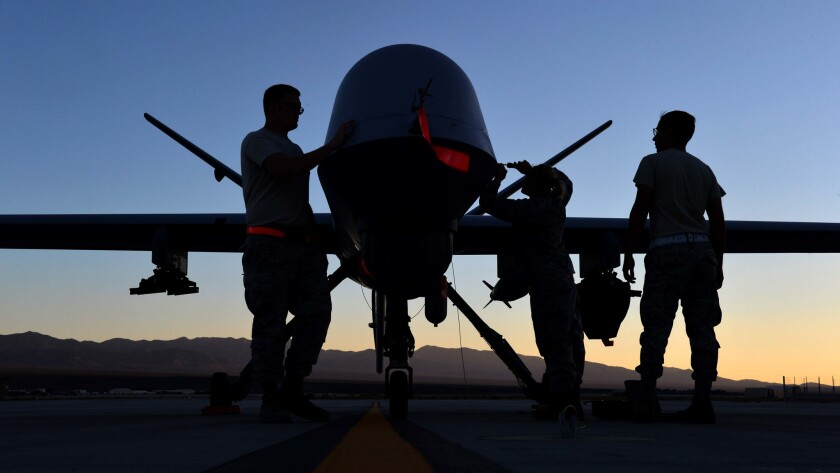 Technicians perform maintenance on an MQ-9 Reaper drone at Creech Air Force Base in Nevada.