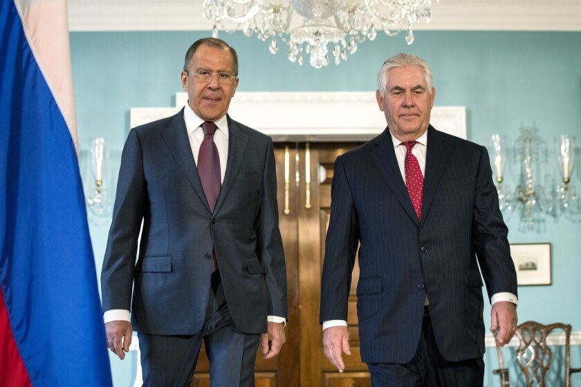 U.S. Secretary of State Rex Tillerson, right, with Russian Foreign Minister Sergey Lavrov at the Sta