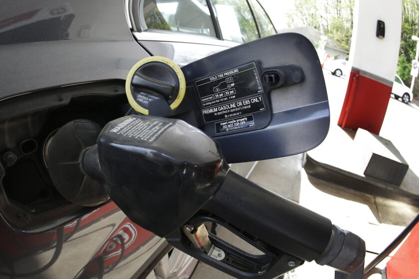 Gasoline getting pumped into a car .