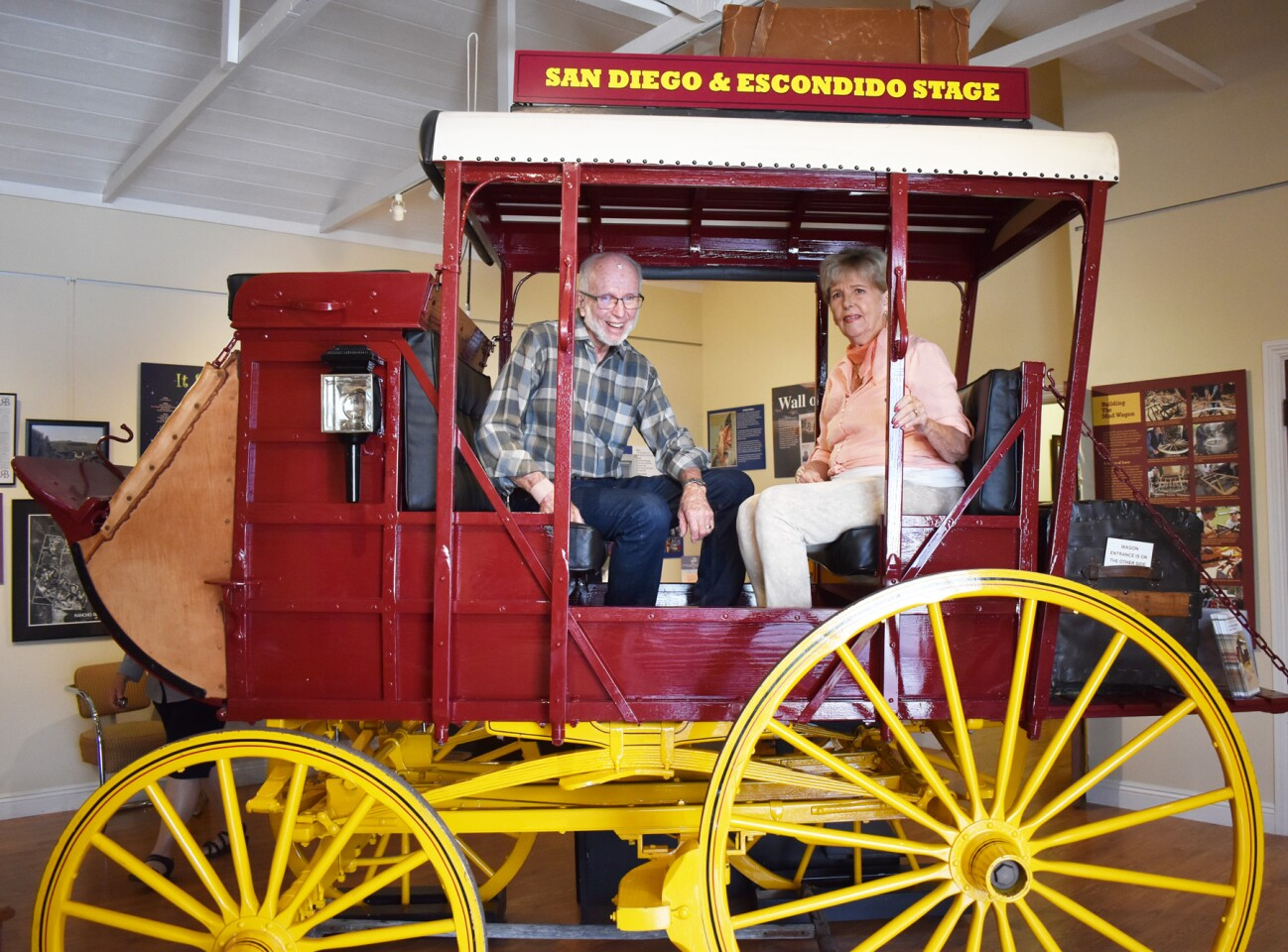 RB Historical Society board members Fred and Carol Gahm in the museum's mud wagon.