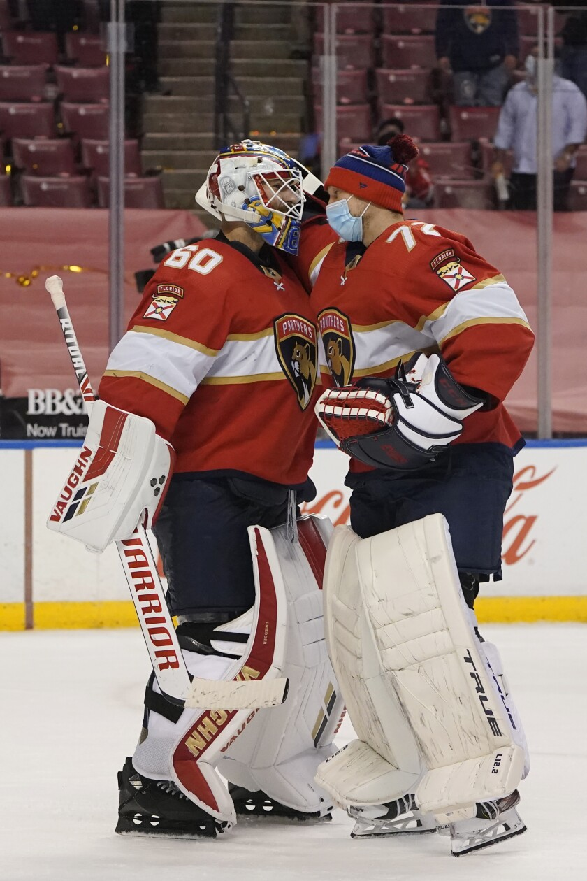 Florida Panthers goaltender Chris Driedger (60) is congratulated by goaltender Sergei Bobrovsky (72) after they defeated the Nashville Predators during an NHL hockey game, Friday, Feb. 5, 2021, in Sunrise, Fla. (AP Photo/Wilfredo Lee)