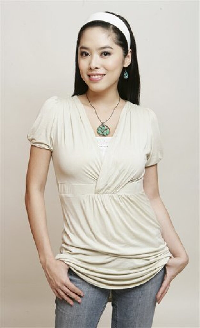 In this Sept. 2007 photo, TV show personality Grace Lee poses during an interview in Seoul, South Korea. Philippine-Korean relations have suddenly gotten warmer. The Philippines' bachelor President Benigno Aquino III told reporters Wednesday Feb. 1, 2012 that, yes, he is dating again. This time it's a South Korean woman who grew up in Manila and works there as a TV show host and radio disc jockey. (AP Photo/Newsis, Kim Jong-hyun) KOREA OUT
