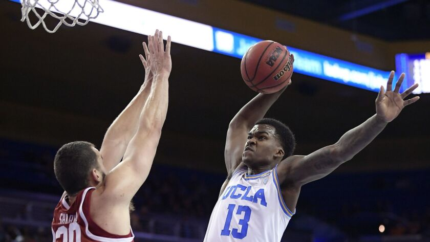 UCLA guard Kris Wilkes, right, goes up for a dunk as Stanford center Josh Sharma defends during the second half.