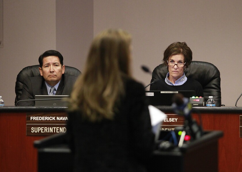 Newport-Mesa Unified School District Supt. Fred Navarro and trustee Karen Yelsey, right – pictured at a 2014 school board meeting – say the board should delay discussion of term limits for trustees.