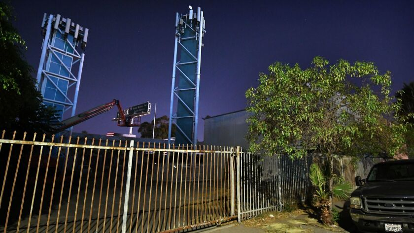 Cell phone towers near the interchange of the 110 and 10 freeway in Los Angeles on Aug. 10.