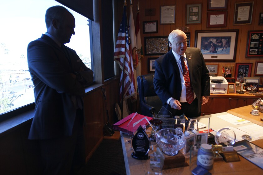 San Diego County supervisor Bill Horn in his office with Chief of Staff Dustin Steiner before the meeting where Horn took over the chairmanship of the San Diego County Board of Supervisors on Tuesda