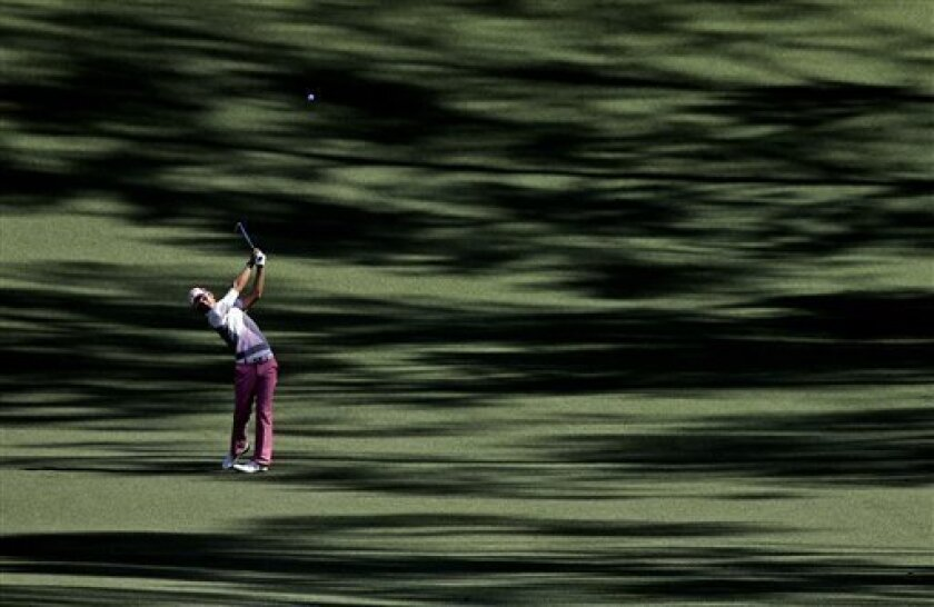 Ryo Ishikawa, of Japan, hits off the 10th fairway during a practice round before the Masters golf tournament Wednesday, April 10, 2013, in Augusta, Ga. (AP Photo/David J. Phillip)