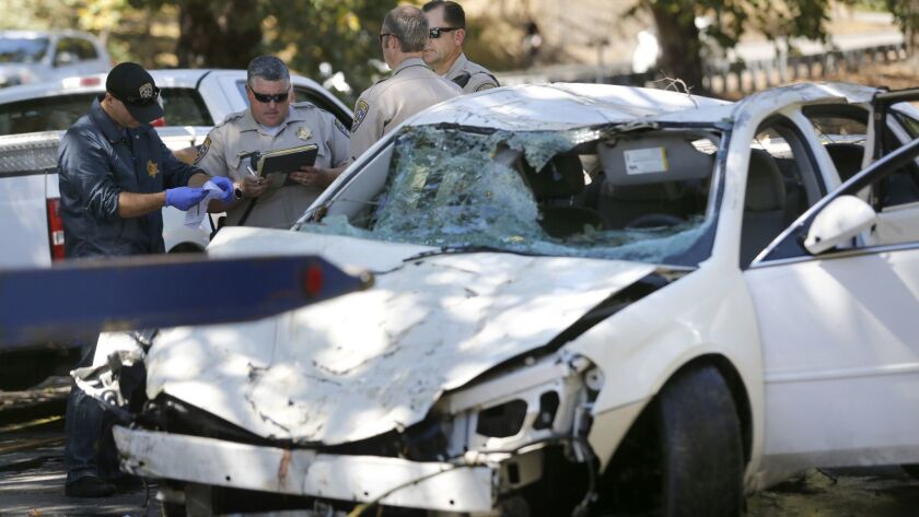 FILE - In this Aug. 31, 2016, file photo, California Highway Patrol officers examine a car after it
