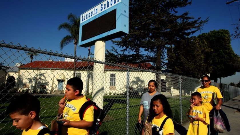 For years, Paramount residents have complained of burning, metallic odors, saying authorities have failed to take sufficient action to protect nearby homes and schools. Above, students and parents walk home from Lincoln Elementary School in Paramount in 2014.