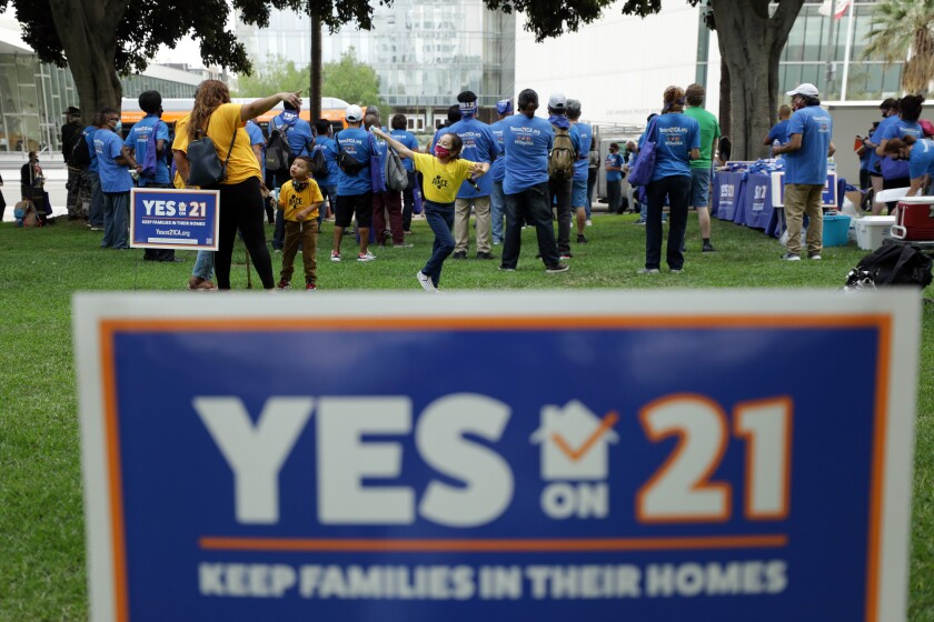 A rally in support of Proposition 21, a statewide rent control ballot measure, was held at L.A. City Hall on Sept. 8.