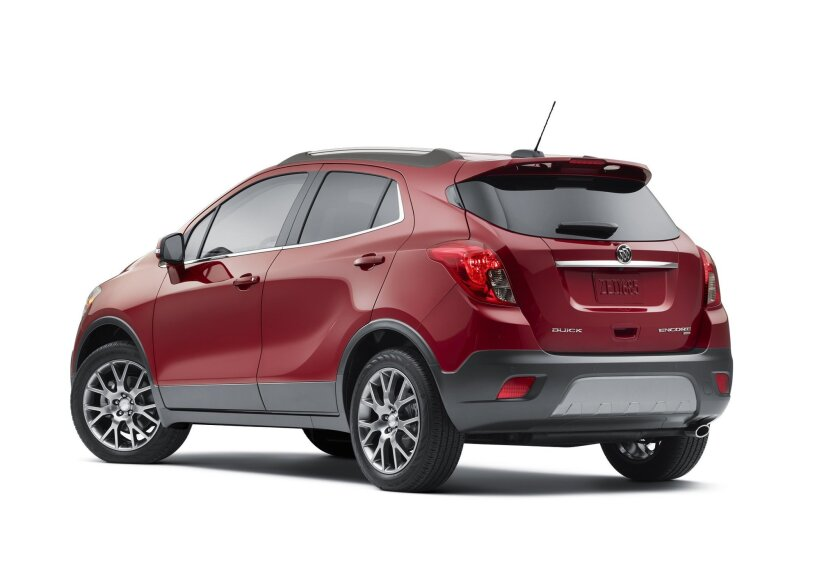 This undated photo provided by General Motors shows the 2016 Buick Encore Sport Touring. Buick's best selling vehicle, the Encore SUV, adds a new Sport Touring model for 2016 that comes with a higher-powered, turbocharged, four-cylinder engine putting out 153-horsepower. The newfound power makes the small Encore SUV, with its affordable pricing and premium amenities and styling, even more appealing to buyers. (Courtesy of General Motors via AP) MANDATORY CREDIT