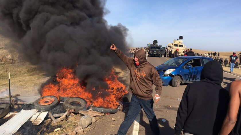 Protesters confront soldiers and law enforcement officers assembled Thursday to force Dakota Access pipeline opponents off private land.