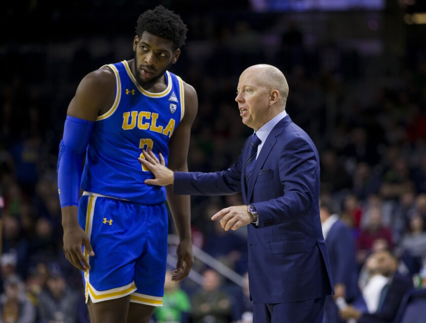 UCLA coach Mick Cronin talks to forward Cody Riley during a loss to Notre Dame on Dec. 14.