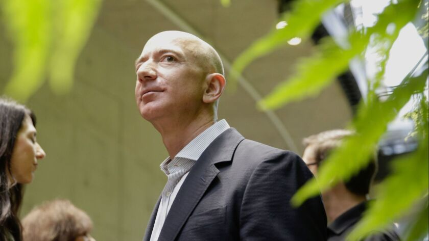 Jeff Bezos tours an Amazon facility at the grand opening of Amazon Spheres in Seattle earlier this year.