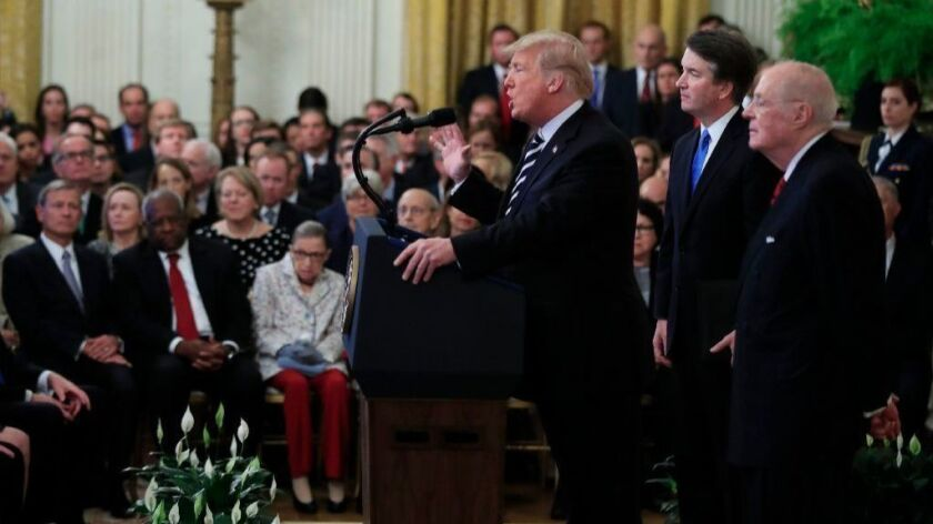 President Trump, with Justice Brett Kavanaugh and retired Justice Anthony M. Kennedy, speaks during Kavanaugh's ceremonial swearing-in.