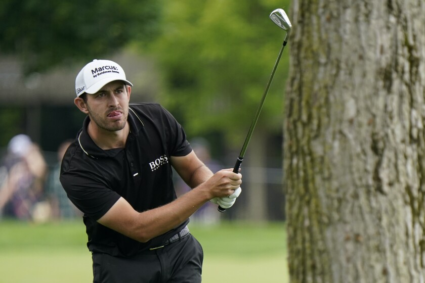 Patrick Cantlay watches his shot to the 13th green during the second round of the Memorial golf tournament, Friday, June 4, 2021, in Dublin, Ohio. (AP Photo/Darron Cummings)