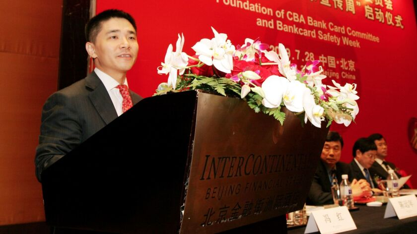 Mao Xiaofeng, then president of China Minsheng Banking Corp., gives a speech in Beijing on July 28,
