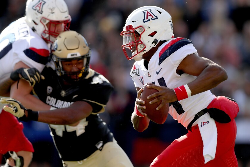 Arizona quarterback Khalil Tate carries the ball against Colorado in the second quarter Saturday in Boulder, Colo.