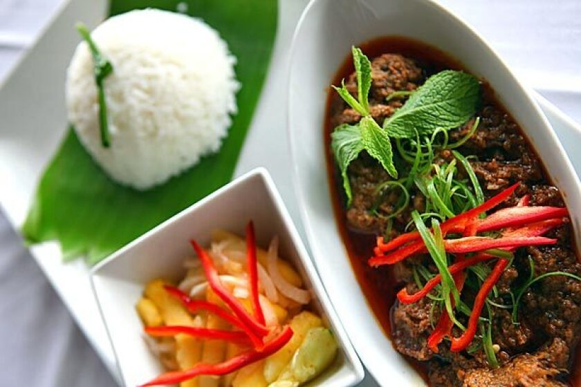 Menu includes beef rendang.