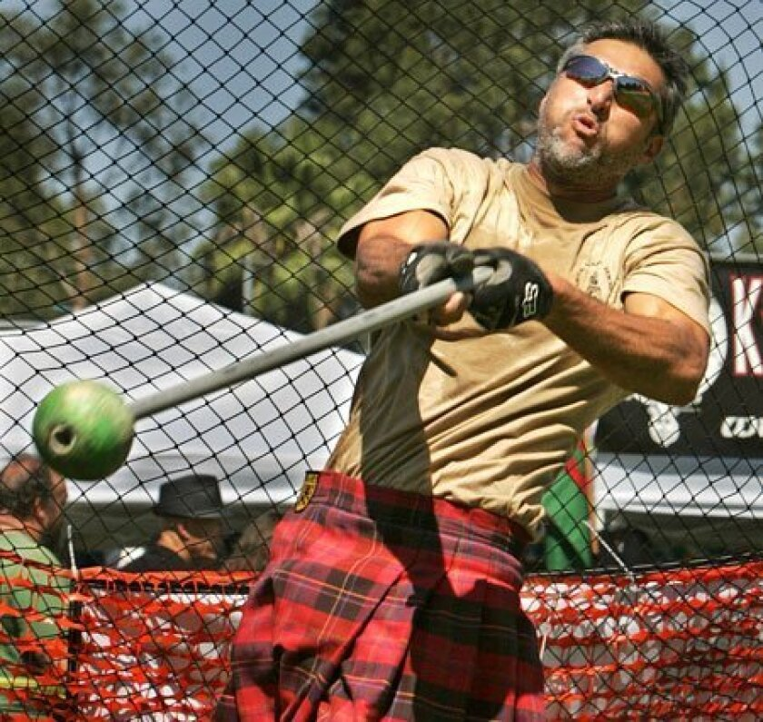 David Counts of Vista unleashed a toss yesterday in the light hammer throw at the 36th San Diego Scottish Highland Games & Gathering of the Clans.  (Howard Lipin / Union-Tribune)