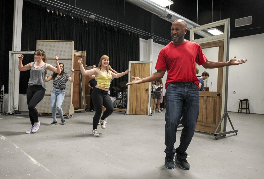 "Actor Ron Jones (right) performs with cast mates during a rehearsal for ""33 1/3: House of Dreams"" at the Rep's rehearsal space."