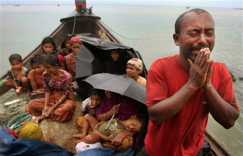 FILE - In this June 13, 2012 file photo, a Rohingya Muslim man who fled Myanmar to Bangladesh to escape religious violence, cries as he pleads from a boat after he and others were intercepted by Bangladeshi border authorities in Taknaf, Bangladesh. Asia's more than 1 million ethnic Rohingya Muslims