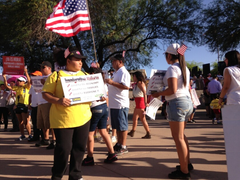 About 300 people gathered at Arizona's state Capitol for a May Day rally. Later, many joined a labor picket line.