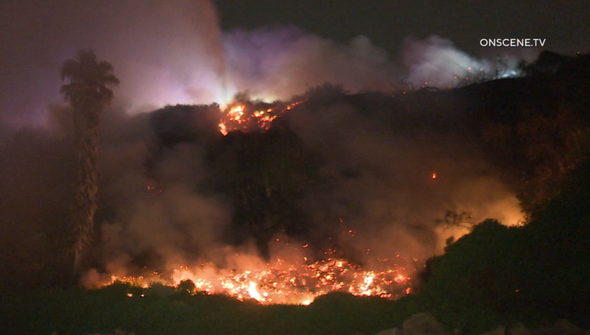 A brush fire burned along the bluffs in Encinitas near South Coast Highway 101 early Wednesday.