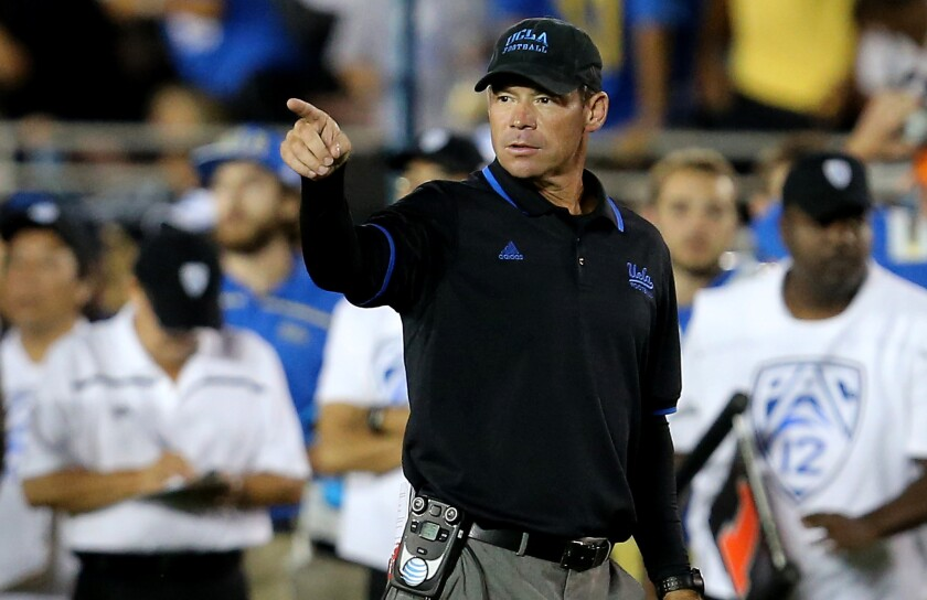 UCLA Coach Jim Mora directs his team against BYU at the Rose Bowl on Sept. 19.
