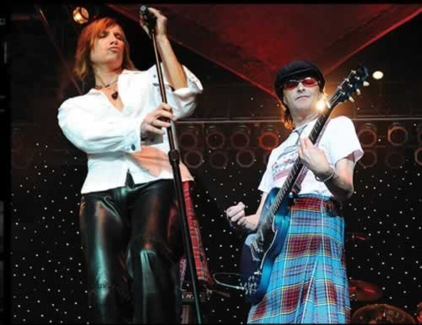 Eric Sage and early Bay City Rollers' guitarist Ian Mitchell on stage performing in their incarnation of the Scottish pop band who recorded the No. 1 1975 radio hit, 'Saturday Night.' Courtesy