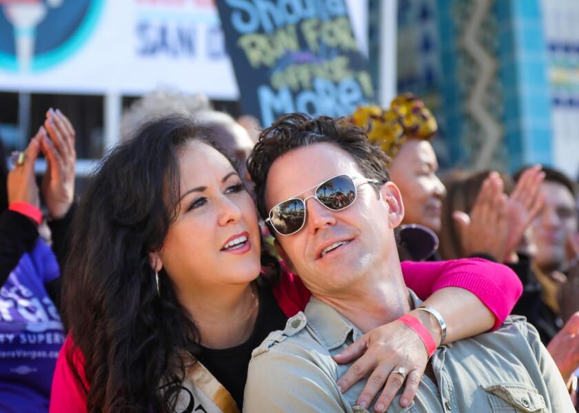 Assemblywoman Lorena Gonzalez and her husband, Nathan Fletcher, attend Women's March San Diego on Jan. 18, 2020.