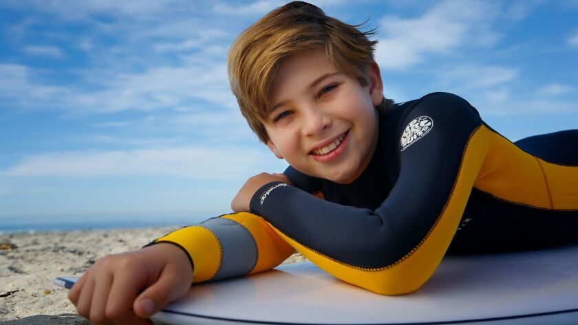 """Noah Baird, 12, of Carlsbad is enjoying his first surfing season at Cardiff State Beach. The young musical theater actor will be featured on """"A Christmas Story: Live"""" on Fox Television Dec. 17."""