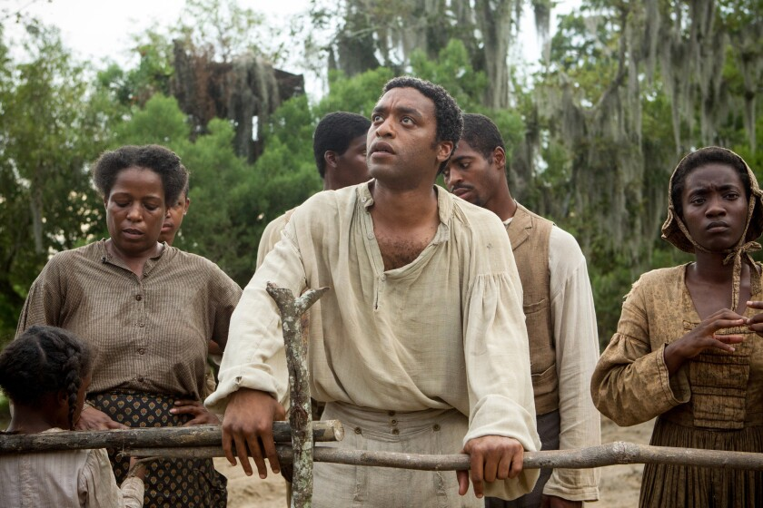 "Chiwetel Ejiofor, center, in a scene from ""12 Years a Slave."""