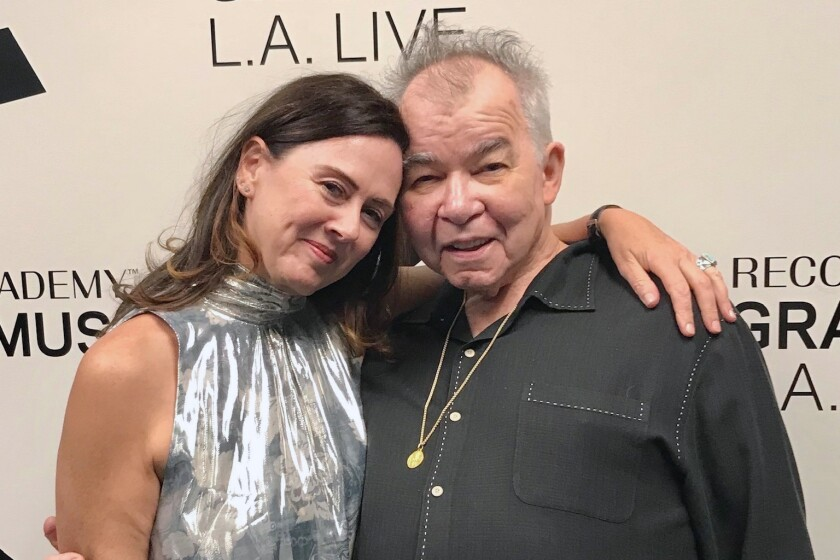 This 2018 photo provided by Fiona Prine shows Prine and her husband, John, in Los Angeles. Both battled COVID-19, but John lost his life to the disease. (Courtesy of Fiona Prine via AP)