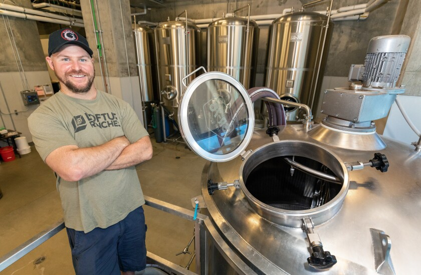 Matt Dale, the master brewer at the Rincon Reservation Road Brewery, is pictured next to a brewing vat.