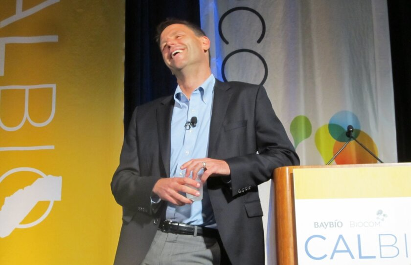 Eric Karpinski shares his happiness at a talk on how to cultivate positive emotions at Friday's CalBio biotech conference in downtown San Diego.