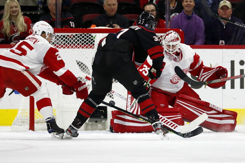 Carolina Hurricanes' Andrei Svechnikov (37), of Russia, shoots the puck past Detroit Red Wings goaltender Jimmy Howard (35) during the first period of an NHL hockey game in Raleigh, N.C., Friday, Nov. 1, 2019. (AP Photo/Karl B DeBlaker)