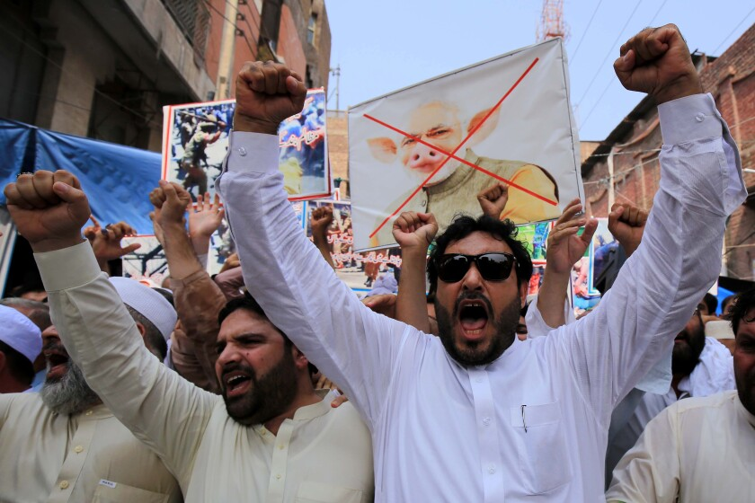 People in Peshawar, Pakistan, on Tuesday protest