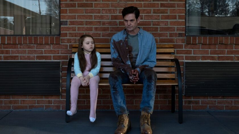 """Violet McGraw and Henry Thomas are part of an embattled family in Netflix's """"The Haunting of Hill House."""""""