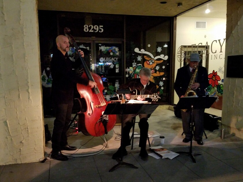 "A band plays on the street at the ""La Mesa Shimmer"" event in 2017. This year, the main holiday event scheduled for the downtown village area in La Mesa is Holiday in the Village, set for Dec. 13 and Dec. 14."