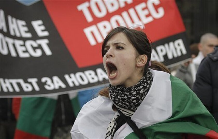 FILE - A Bulgarian woman shout slogans during a protest against higher electricity and heating bills, in Sofia,  in this Sunday, Feb. 17, 2013 file photo. A quarter century after the fall of communism in Bulgaria, dreams of prosperity have turned awfully sour in the Balkan country, which is the poo