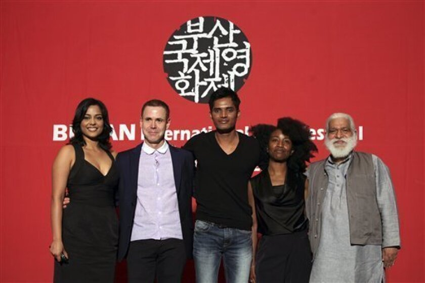 """Producers and actors of Busan International Film Festival's opening movie """"Vara: A Blessing,"""" from left, Indian actress Shahana Goswami, American producer David Urrutia, Indian actor Devesh Ranjan, American producer Nanette Nelms and Indian executive producer Suresh Jindal  pose for photographers a"""