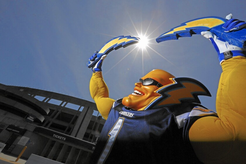 Dan Jauregui -- a.k.a. Boltman -- poses outside Qualcomm Stadium in San Diego. He's not a team mascot but a season ticket holder with extraordinary team loyalty. He remains confident the team will stay in San Diego — but if they don't, he is ready. He will not follow the team elsewhere.