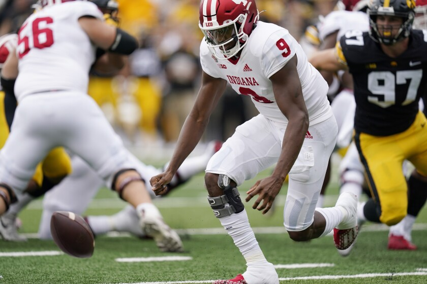 Indiana quarterback Michael Penix Jr. (9) fumbles the ball during the first half of an NCAA college football game against Iowa, Saturday, Sept. 4, 2021, in Iowa City, Iowa. (AP Photo/Charlie Neibergall)