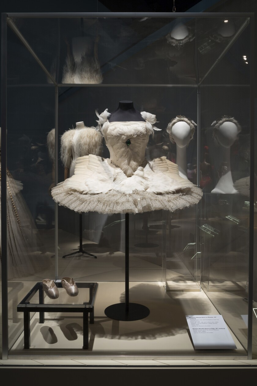 """This photo provided by The Museum at FIT shows the """"Dying Swan"""" tutu, head piece, and pointe shoes worn by iconic Russian ballerina Anna Pavlova, that are part of the new exhibit at the Fashion Institute of Technology in New York. The exhibit features 90 items, including ballet costumes, high fashion and athletic wear, or what we call today """"athleisure."""" (Eileen Costa/The Museum at FIT via AP)"""