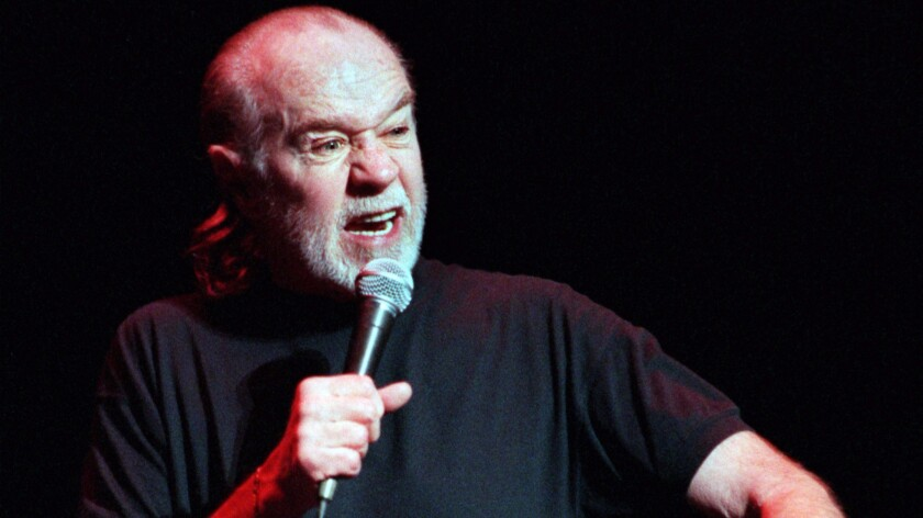 """The late comedian George Carlin, whose comedy routine about the """"Seven Dirty Words"""" banned from broadcast by the FCC became infamous in the late 1970s, performs in Orange County in 1999."""
