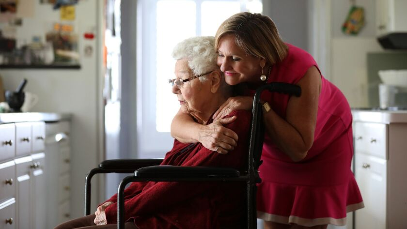 Margaret Wardlow hugs her mother Dolores McKeown, 97, in her McKeown's Cathedral City home. Wardlow was raped by the Golden State Killer in 1977, when she was 13.
