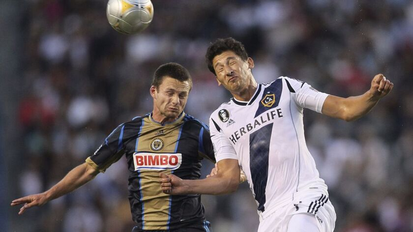 CARSON, CA – JULY 04: Jack McInerney @@#9 of the Philadelphia Union and Omar Gonzalez @@#4 of the Lo